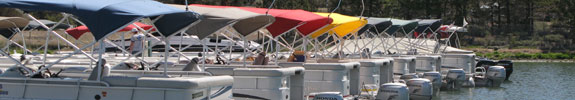 A full lineup of our rental boats on a wooden dock.