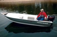 one of our aluminum fishing boats on a calm lake